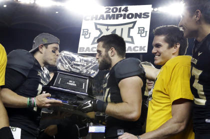 Baylor's Bryce Petty (L) and Bryce Hager kiss the Big 12 trophy after their win over K-State. (AP)