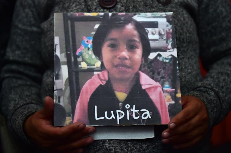 Luz Maria Medina holds a photo of her four-year-old niece Lupita, who was found murdered on March 18, 2017 in the state of Mexico -- a case that highlights deadly violence against girls and women in Mexico
