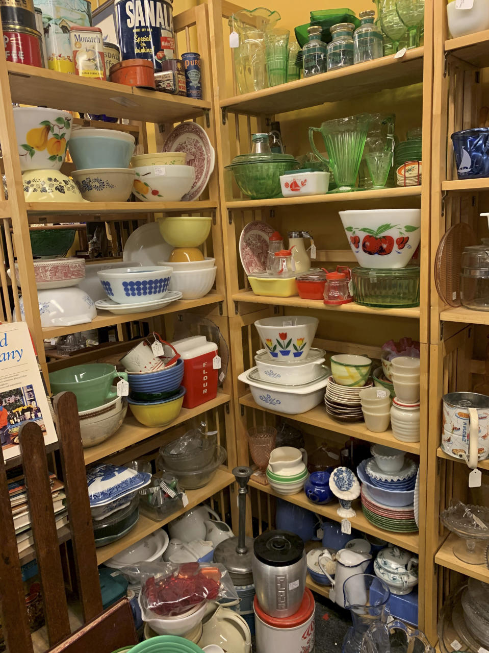"""This image provided by Tracee Herbaugh exhibits some of the vintage kitchenware available at a Waltham, Massachusetts antique shop. Television and social media have also generated interest. Series like """"WandaVision,"""" """"Firefly Lane,"""" """"The Marvelous Mrs. Maisel"""" and """"Mad Men"""" all highlight midcentury kitchens and kitchenware. (Tracee Herbaugh via AP)"""