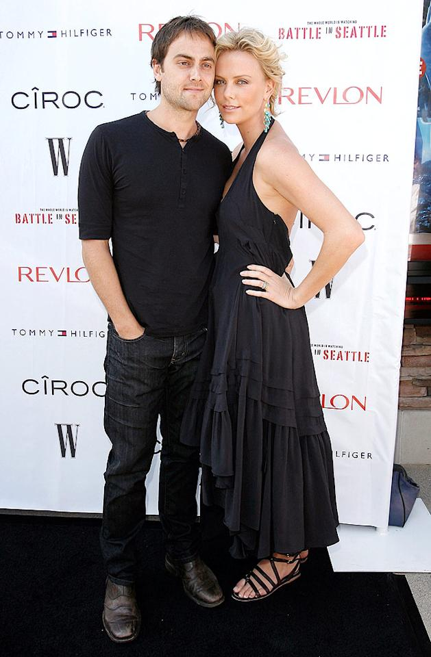 "Charlize Theron arrives with boyfriend Stuart Townsend at an exclusive screening of his film, ""Battle in Seattle,"" hosted by W Magazine in Malibu. Charlize also stars in the flick, which marks Stuart's writing/directing debut. Donato Sardella/<a href=""http://www.wireimage.com"" target=""new"">WireImage.com</a> - June 29, 2008"