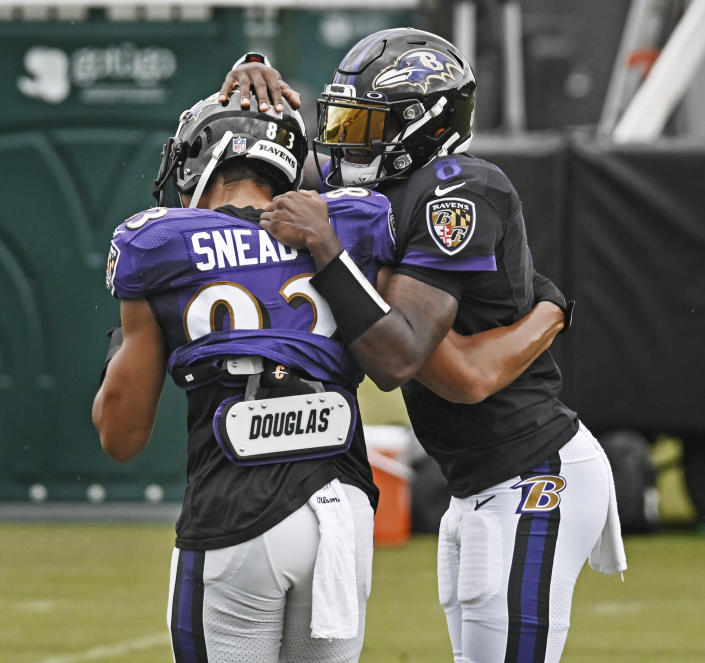 Lamar Jackson, right, jokes with teammate Willie Snead IV during training camp on Aug., 31, 2020. Jackson's bond with his Ravens teammates adds to the motivation. (Kenneth K.Lam/The Baltimore Sun via AP)