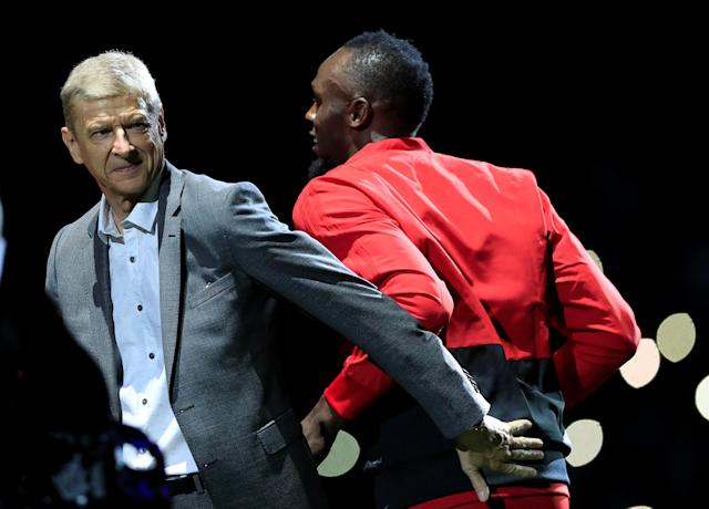 Soccer Football - France 98 v FIFA 98 Selection - U Arena Stadium, Nanterre, France - June 12, 2018 FIFA 98 coach Arsene Wenger and FIFA 98's Usain Bolt REUTERS/Gonzalo Fuentes