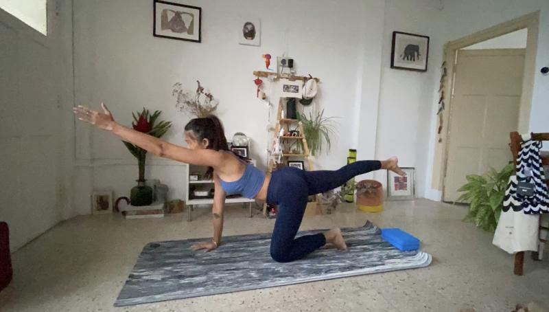 The writer trying out one of the online yoga classes. (PHOTO: Reta Lee/Yahoo Lifestyle SEA)