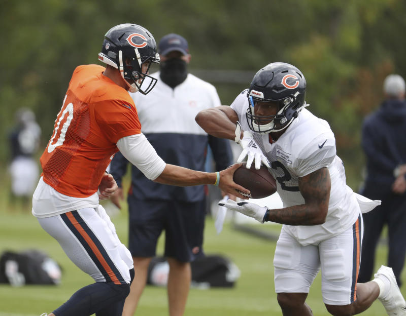 Chicago Bears quarterback Mitch Trubisky (10) hands off to running back David Montgomery (32) during NFL football training camp Tuesday, Aug. 25, 2020, at Halas Hall in Lake Forest, Ill. (Brian Cassella/Chicago Tribune via AP, Pool)