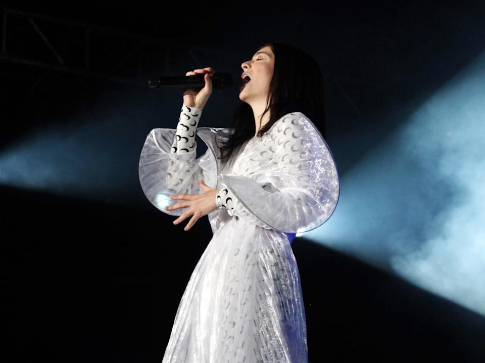 <p>Lorde on stage in 2018</p> (AFP via Getty Images)