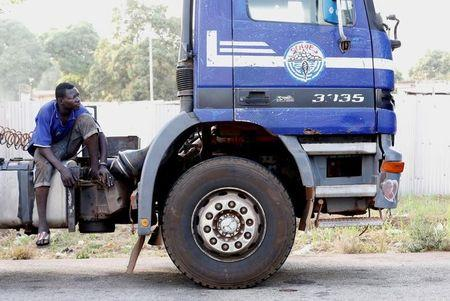 A man sits on a truck in Djebonoua, outside Bouake, as disgruntled soldiers demanding salary increases seized the city of Bouake, Ivory Coast