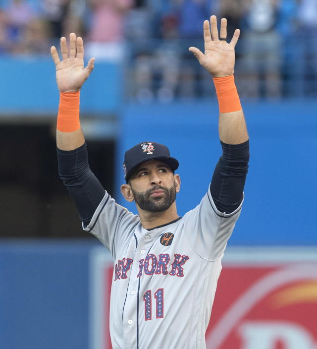 New York Mets' Jose Bautista acknowledges the crowd before the team's baseball game against the Toronto Blue Jays, his former team, in Toronto on Tuesday, July 3, 2018. (Fred Thornhill/The Canadian Press via AP)