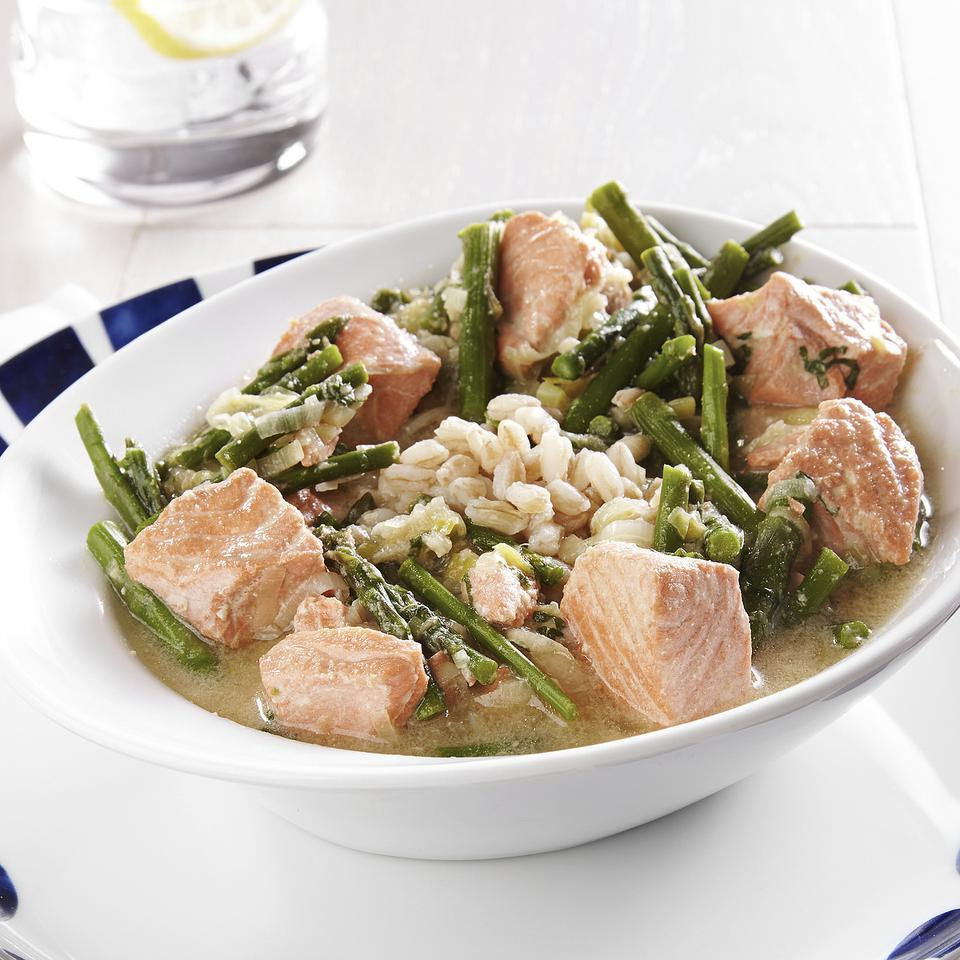 "<p>In this farro and salmon recipe, salmon is poached in a miso-infused broth with bites of tender asparagus and sautéed leeks. If you use farro that's labeled ""pearled,"" a faster-cooking farro, to make this recipe, start with a full cup of grains and reduce the cooking time to 15 minutes. To clean the leeks, trim off the green tops and white roots and split lengthwise. Place in a large bowl of water and swish around to release any sand or soil. Repeat until no grit remains. <a href=""http://www.eatingwell.com/recipe/250939/salmon-asparagus-farro-bowl/"" rel=""nofollow noopener"" target=""_blank"" data-ylk=""slk:View recipe"" class=""link rapid-noclick-resp""> View recipe </a></p>"