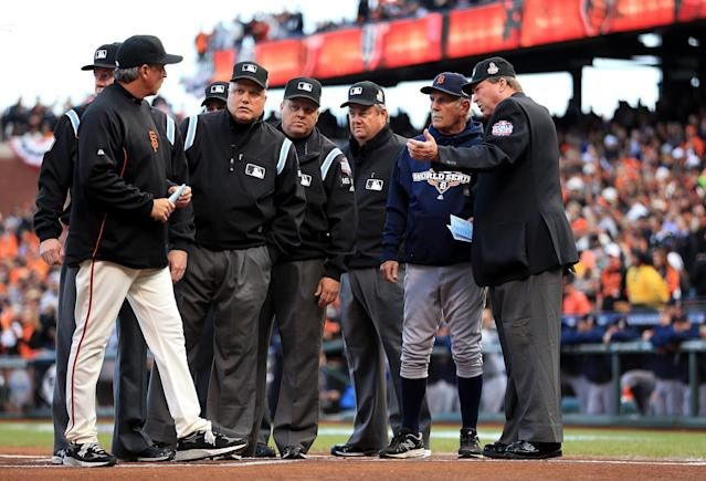 SAN FRANCISCO, CA - OCTOBER 24: Manager Bruce Bochy #15 of the San Francisco Giants and Manager Jim Leyland #10 of the Detroit Tigers go over ground rules with the umpire prior to Game One of the Major League Baseball World Series at AT&T Park on October 24, 2012 in San Francisco, California. (Photo by Doug Pensinger/Getty Images)