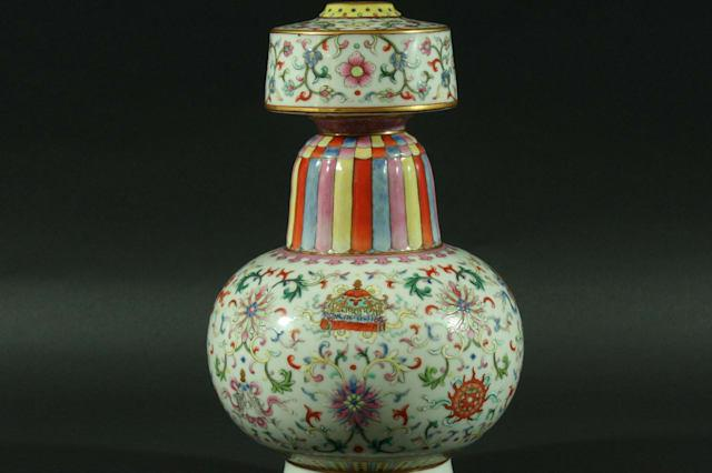 Auctioneers were left stunned when this Chinese vase valued at £1,200 was sold for a staggering £307,000 - despite possibly being a COPY. See SWNS story SWVASE; The Chinese Tibetan style temple vase is enamelled with scrolling flowers and the Eight Buddhist Treasures on a white ground. But while it looks like a vase from the Jiaqing period, 1796-1820, the 26.5cm high vase is believed to have been made in the early 20th century known as the Republic period. It was initially bought by a British solicitor when he was working in Shanghai around 100 years ago.
