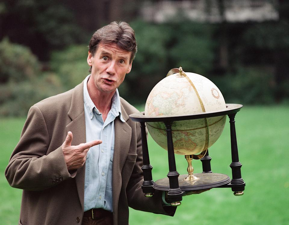 Writer and actor Michael Palin with a globe, 8th October 1992. (Photo by Mike Maloney/Mirrorpix/Getty Images)