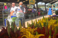 Shoppers look through offerings of flowers and vegetable plants Friday, May 22, 2021, at the Capitol Market in Charleston, W.Va. West Virginia has seen a higher percentage of residents depart than any other state in the past decade. (AP Photo/John Raby)
