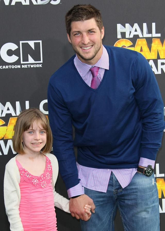 SANTA MONICA, CA - FEBRUARY 18: NFL player Tim Tebow (R) and Presley Collins attend the 2nd Annual Cartoon Network Hall of Game Awards at Barker Hangar on February 18, 2012 in Santa Monica, California. (Photo by David Livingston/Getty Images)