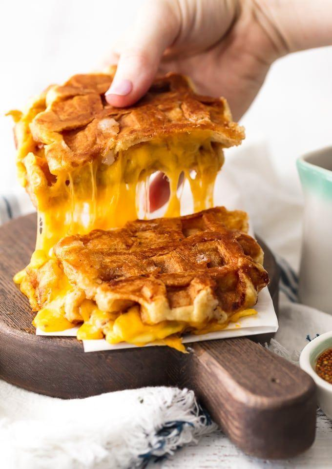 "<p>This cheese creation will be the most decadent sandwich you've ever tasted.</p><p><strong>Get the recipe at <a href=""https://www.thecookierookie.com/apple-cheddar-waffle-sandwich-waffle-grilled-cheese/"" rel=""nofollow noopener"" target=""_blank"" data-ylk=""slk:The Cookie Rookie"" class=""link rapid-noclick-resp"">The Cookie Rookie</a>.</strong></p><p><a class=""link rapid-noclick-resp"" href=""https://www.amazon.com/Cuisinart-WMR-C-Classic-Round-Waffle/dp/B00004S9D2/?tag=syn-yahoo-20&ascsubtag=%5Bartid%7C10050.g.650%5Bsrc%7Cyahoo-us"" rel=""nofollow noopener"" target=""_blank"" data-ylk=""slk:SHOP WAFFLE MAKERS"">SHOP WAFFLE MAKERS</a></p><p><strong><br></strong></p>"