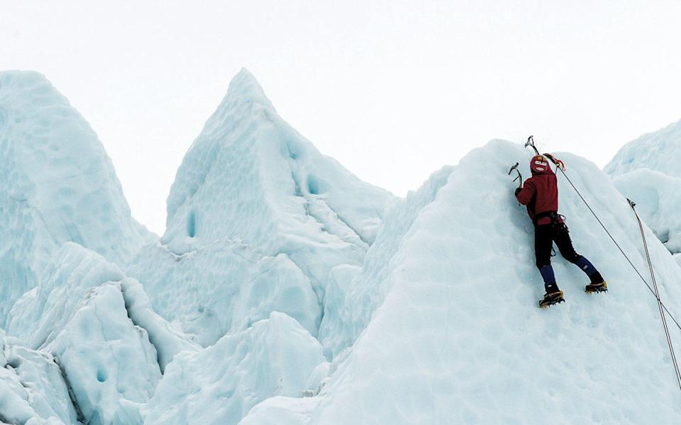 Tim Emmett climbing in the Yukon
