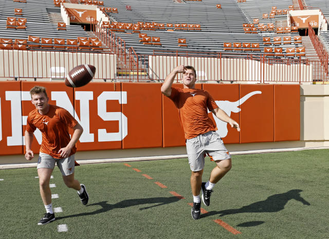 Texas Longhorns' Sam Saxton (left) and Sam Ehlinger play football during Family Friday practice held Friday Sept. 6, 2019 at Darrell K Royal-Texas Memorial Stadium in Austin, Tx. ( Photo by Edward A. Ornelas )
