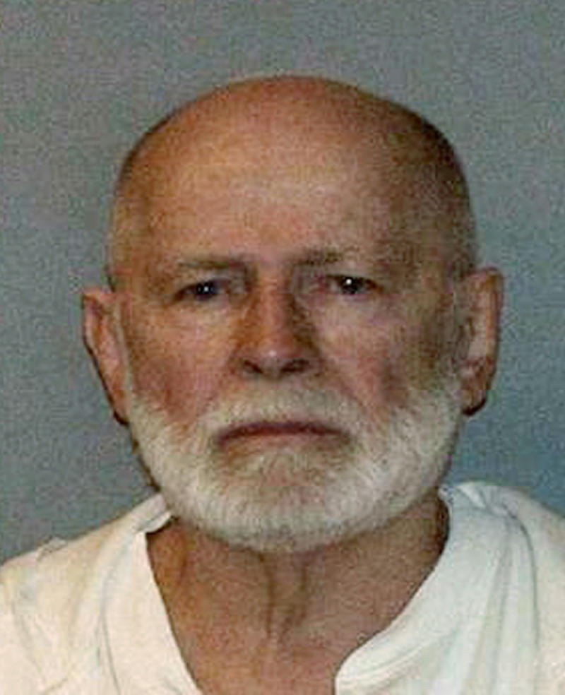"""FILE - This undated file booking photo, obtained by WBUR 90.9 - NPR Radio Boston, shows Boston mob boss James """"Whitey"""" Bulger, who was captured on June 22, 2011, in Santa Monica, Calif., after 16 years on the lam. A judge is set to hear arguments on Bulger's claim that he was given immunity to commit crimes while he was an FBI informant. The 83-year-old Bulger is awaiting trial in a racketeering indictment accusing him of participating in 19 murders. He claims a federal prosecutor gave him immunity for his crimes while he was providing the FBI information on local leaders of the Mafia, his gang's main rivals. (AP Photo/WBUR 90.9, File)  MANDATORY CREDIT"""
