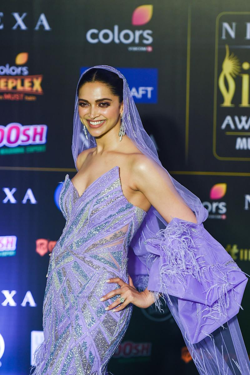 Deepika Padukone in custom purple gown and veil by Gaurav Gupta at the 20th International Indian Film Academy (IIFA) Awards in Mumbai. Padukaone won the Special 20 Award for <i>Chennai Express</i>. (Photo: PUNIT PARANJPE via Getty Images)