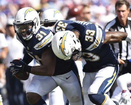 Sep 16, 2018; Orchard Park, NY, USA; Los Angeles Chargers defensive back Adrian Phillips (right) makes an interception as defensive back Derwin James (33) joins in a celebration during the third quarter against the Buffalo Bills at New Era Field. Mandatory Credit: Mark Konezny-USA TODAY Sports