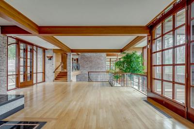 Elegant, clean architecture with a midcentury modern influence defines the living areas. Exposed brick, various woods and stone are used throughout the home. NewJerseyLuxuryAuction.com