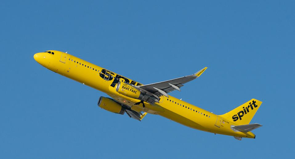 Spirit Airlines plane flies through the sky.