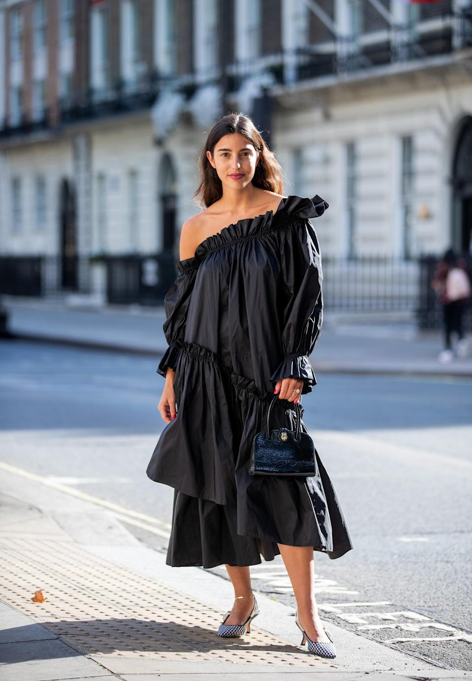 """Midis are the most versatile dresses you could own. The calf-length makes them comfortable enough to wear for casual activities and suitable for more formal occasions. Take your pick from classic <a href=""""https://www.glamour.com/gallery/best-shirt-dresses?mbid=synd_yahoo_rss"""" rel=""""nofollow noopener"""" target=""""_blank"""" data-ylk=""""slk:shirt dresses"""" class=""""link rapid-noclick-resp"""">shirt dresses</a> or trendier silhouettes in bold, <a href=""""https://www.glamour.com/story/70s-fashion-trends?mbid=synd_yahoo_rss"""" rel=""""nofollow noopener"""" target=""""_blank"""" data-ylk=""""slk:'70s-inspired"""" class=""""link rapid-noclick-resp"""">'70s-inspired</a> prints."""