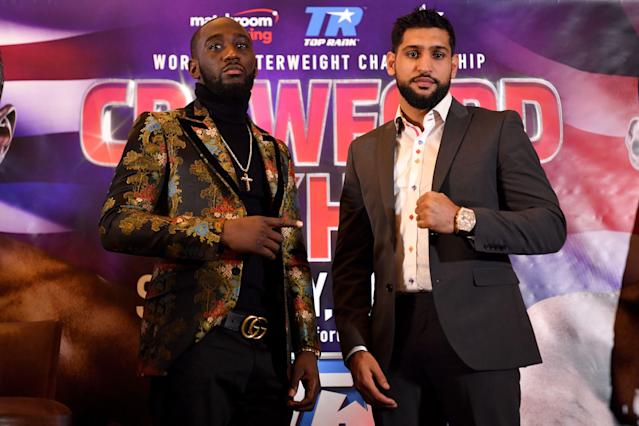 Terence Crawford and Amir Khan face up during a news conference on Jan. 15, 2019 in London. (Getty Images)