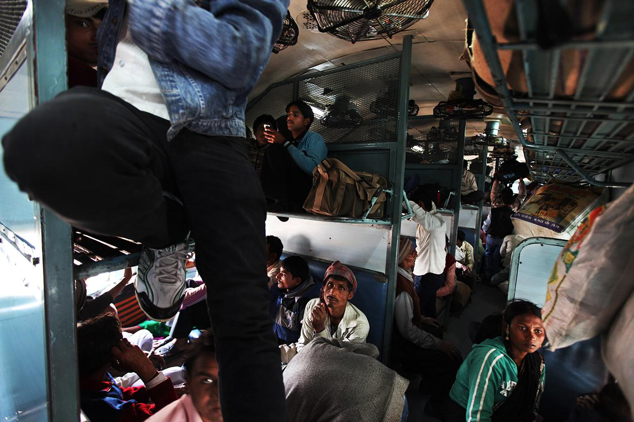 Passenagers settle inside an overcrowded train in New Delhi, India.