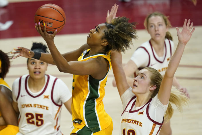 Baylor guard DiDi Richards drives to the basket past Iowa State guard Kylie Feuerbach, right, during the second half of an NCAA college basketball game, Sunday, Jan. 31, 2021, in Ames, Iowa. Baylor won 85-77. (AP Photo/Charlie Neibergall)