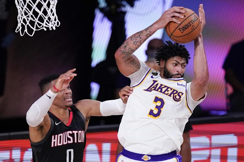 The Lakers' Anthony Davis grabs a rebound over the Rockets' Russell Westbrook during the second half.
