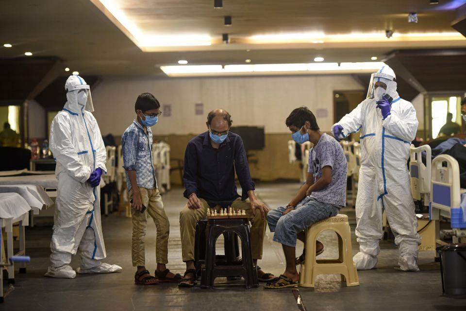 Covid-19 infected patients seen playing chess inside the Shehnai Banquet Hall quarantine centre attached to LNJP Hospital  on July 8, 2020 in New Delhi, India.  (Photo by Biplov Bhuyan/Hindustan Times via Getty Images)