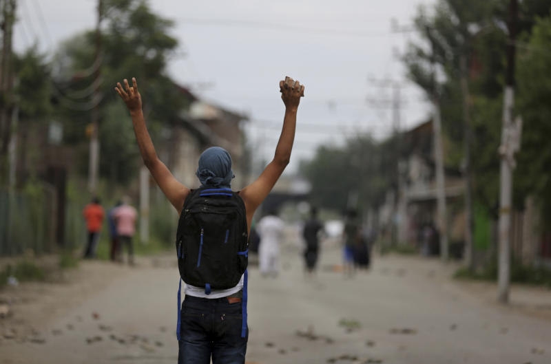 A Kashmiri protester shouts slogans during an anti-India protest in Srinagar, India, Friday, Aug. 9, 2019.  (AP Photo/Altaf Qadri)