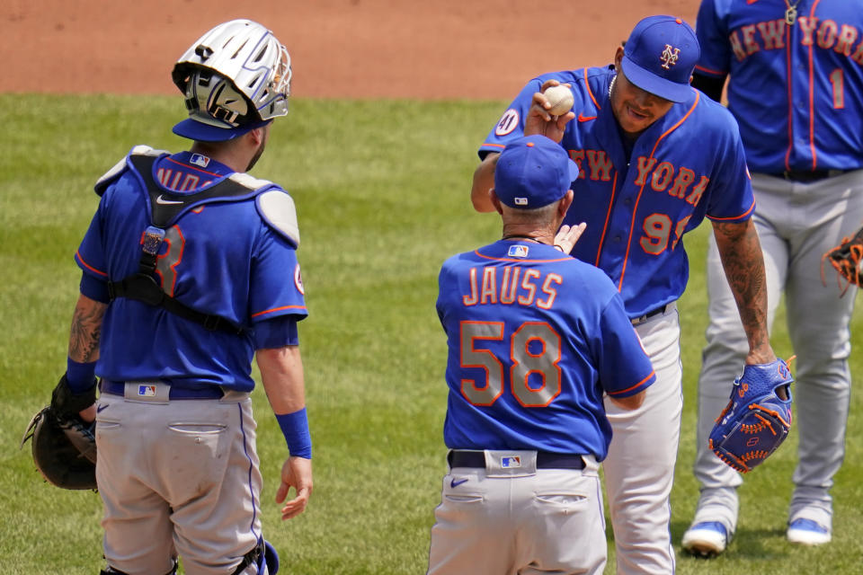 New York Mets starting pitcher Taijuan Walker (99) hands the ball to bench coach Dave Jauss (58), who took over managing duties after manager Luis Rojas was ejected, during the first inning of the team's baseball game against the Pittsburgh Pirates in Pittsburgh, Sunday, July 18, 2021. (AP Photo/Gene J. Puskar)