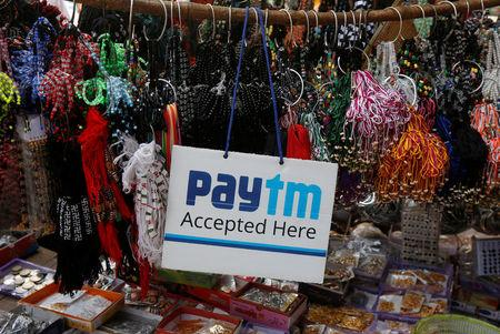 An advertisement of Paytm, a digital wallet company, is pictured at a road side stall in Kolkata
