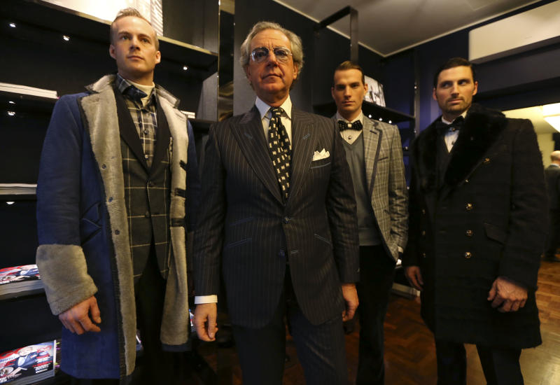 Italian fashion designer Angelo Galasso, second from left, poses with models during a presentation of the Angelo Galasso men's Fall-Winter 2013-14 collection, part of the Milan Fashion Week, unveiled in Milan, Italy, Sunday, Jan. 13, 2013. (AP Photo/Luca Bruno)