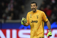 Juventus' goalkeeper Gianluigi Buffon gives instructions to his teammates during the Champions League Group D soccer match between Bayer Leverkusen and Juventus at the BayArena in Leverkusen, Germany, Wednesday, Dec. 11, 2019. (AP Photo/Martin Meissner)