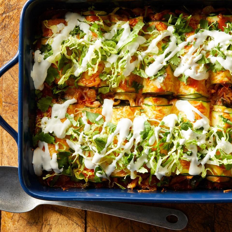 <p>Using thinly sliced zucchini in place of tortillas is a great way to cut back on carbs and still enjoy cheesy chicken enchiladas. If you like the heat, opt for a spicy enchilada sauce.</p>