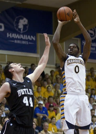 Butler center Andrew Smith (44) guards Marquette forward Jamil Wilson (0) during the first half of an NCAA college basketball game Monday, Nov. 19, 2012, in Lahaina, Hawaii. (AP Photo/Eugene Tanner)