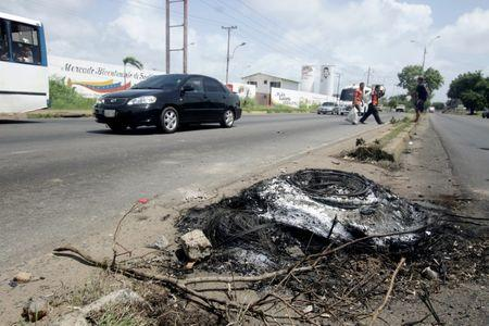 The remains of a police motorcycle burned by protestors, after a twelve-year-old boy was killed during a demonstration, is seen in San Felix, Venezuela, July 17, 2017. REUTERS/William Urdaneta