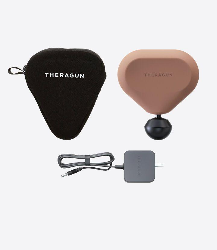 """<p><strong>Theragun</strong></p><p>theragun.com</p><p><strong>$199.00</strong></p><p><a href=""""https://go.redirectingat.com?id=74968X1596630&url=https%3A%2F%2Fwww.theragun.com%2Fus%2Fen-us%2Fmini-us.html&sref=https%3A%2F%2Fwww.elledecor.com%2Flife-culture%2Ftravel%2Fg36806316%2Fsummer-travel-necessities%2F"""" rel=""""nofollow noopener"""" target=""""_blank"""" data-ylk=""""slk:Shop Now"""" class=""""link rapid-noclick-resp"""">Shop Now</a></p><p>Here's something you didn't think you needed, but you definitely do. Riding in cramped planes, trains, and buses for long periods of time is never comfortable; at just six inches wide, the mini Theragun massager will help with loosening up those knots after a long trip.</p>"""