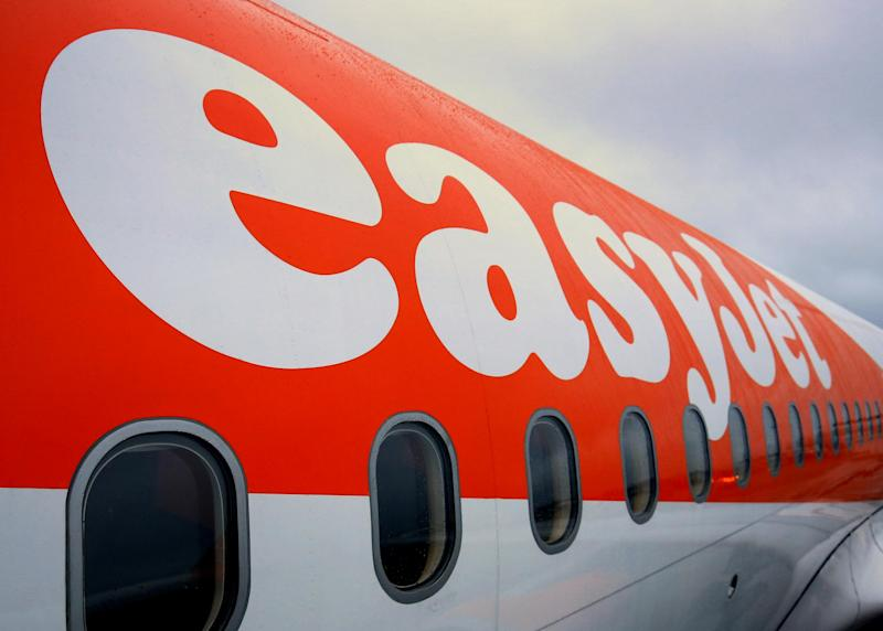 Passengers board an EasyJet flight. Now about nine million people have had their travel details compromised: PA