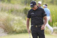 Phil Mickelson reacts after his double boggie shot on the 13th hole during the third round at the PGA Championship golf tournament on the Ocean Course, Saturday, May 22, 2021, in Kiawah Island, S.C. (AP Photo/David J. Phillip)