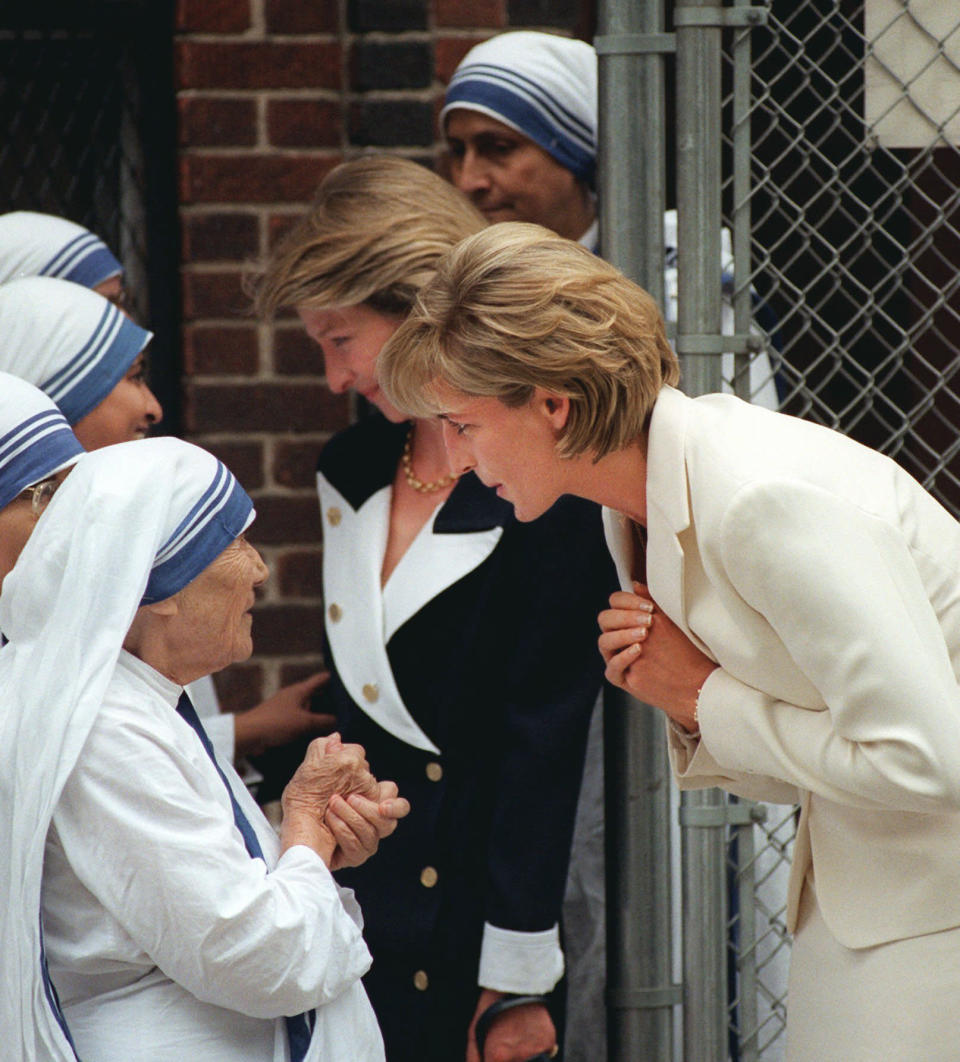 """FILE - In this June 18, 1997 file photo, Mother Teresa, left, says goodbye to Princess Diana after receiving a visit from her in New York. For someone who began her life in the spotlight as """"Shy Di,"""" Princess Diana became an unlikely, revolutionary during her years in the House of Windsor. She helped modernize the monarchy by making it more personal, changing the way the royal family related to people. By interacting more intimately with the public -- kneeling to the level of children, sitting on edge of a patient's hospital bed, writing personal notes to her fans -- she set an example that has been followed by other royals as the monarchy worked to become more human and remain relevant in the 21st century. (AP Photo/Bebeto Matthews, File)"""