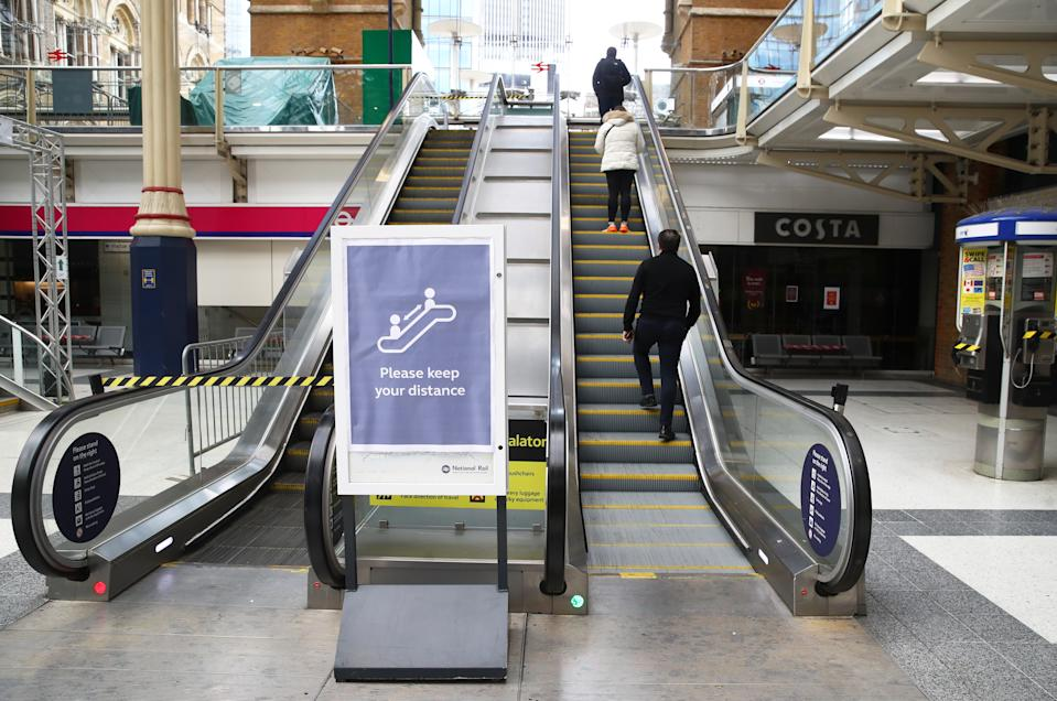 Safe distancing is observed on the escalators exiting Liverpool Street Station during rush hour on May 13, 2020 in London. (Photo by Julian Finney/Getty Images)