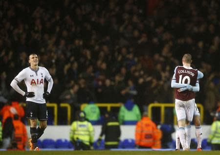 Jack Collison and Ravel Morrison of West Ham United celebrate as Tottenham Hotspur's Vlad Chiriches looks up after West Ham won 2-1 in their English League Cup quarter-final soccer match at White Hart Lane, London, December 18, 2013. REUTERS/Andrew Winning