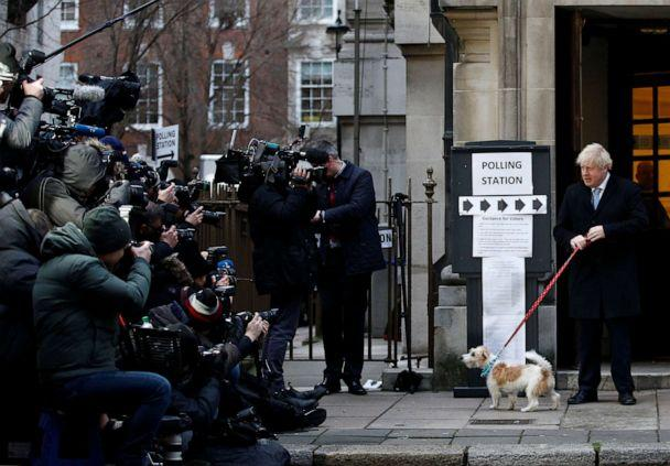 PHOTO: Britain's Prime Minister Boris Johnson arrives with his dog Dilyn at a polling station, at the Methodist Central Hall, to vote in the general election in London, England, Dec. 12, 2019. (Henry Nicholls/Reuters)