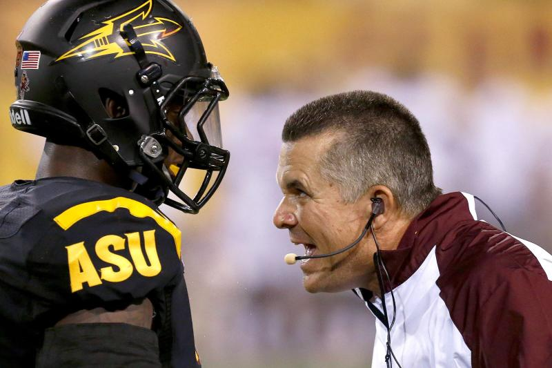 FILE - In this Sept. 14, 2013, file photo, Arizona State head coach Todd Graham, right, tries to make a point to Anthony Jones during the second half in an NCAA college football game against Wisconsin. Arizona State has gotten through a difficult stretch in the schedule in decent shape outside of a horrendous start against No. 5 Stanford. Beating Notre Dame on Saturday at the end of this four-game gauntlet would be a nice capper for the No. 22 Sun Devils, giving them a huge boost on the national stage. (AP Photo/Ross D. Franklin, File_
