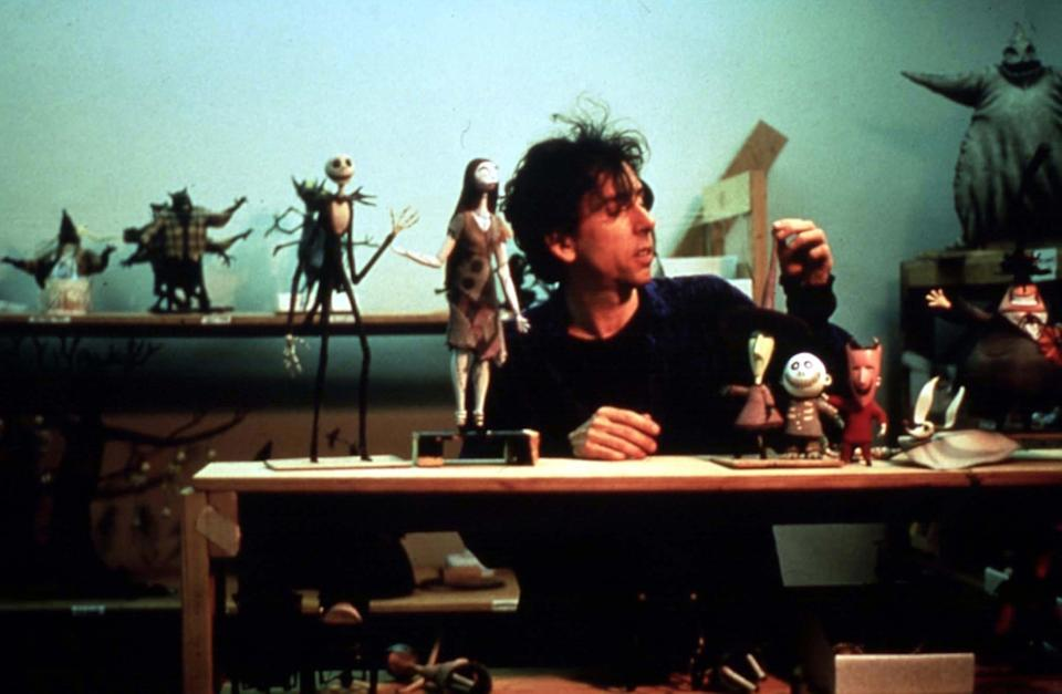 Producer Tim Burton with stop-motion characters from <em>The Nightmare Before Christmas.</em> (Image: Disney/Buena Vista Pictures/Everett Collection)