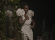 """<p>Next is Nyong'o, who appears in a stunning white gown as Beyoncé sings: """"Pretty like Lupita when the cameras close in,"""" referring to the actress's successful career. Nyong'o won an Oscar in 2014 for her role in <em>12 Years a Slave</em>. </p>"""