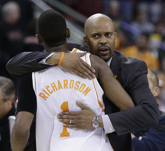 Tennessee head coach Cuonzo Martin embraces Tennessee guard Josh Richardson after the second half of an NCAA college basketball third-round tournament game against Mercer, Sunday, March 23, 2014, in Raleigh. Tennessee Won 83-63. (AP Photo/Chuck Burton)